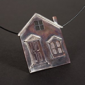 A side view of the house pendant.