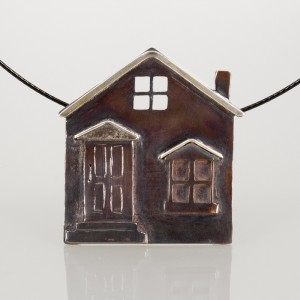 A cool house pendant made of copper and silver.