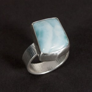 A lovely blue larimar stone in a textured sterling silver ring.